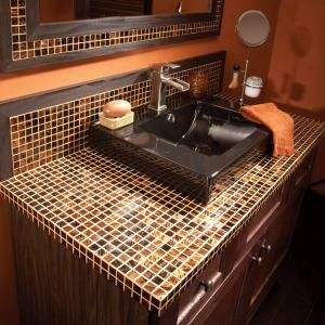 Make a gorgeous bathroom vanity top from mosaic glass tiles. Available in hundreds of colors and styles, they're small enough that you can avoid cuts just by adjusting the size of the top. These glass tiles are available at any home improvement store.