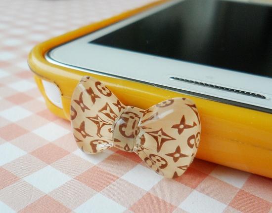 Louis Vuitton designer trademark infringing purses for phone plugs.