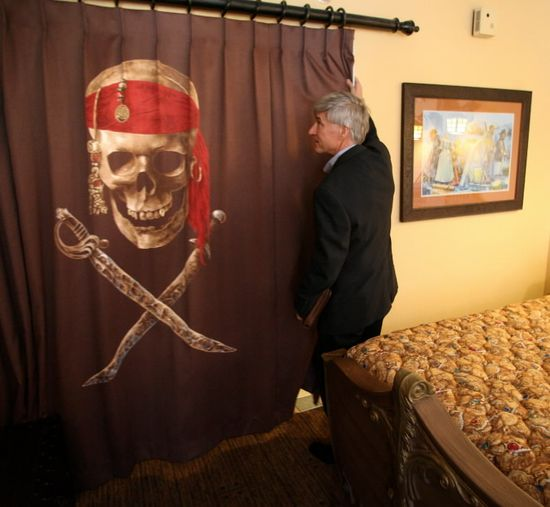 """Pirate-themed rooms at Disney's Caribbean Beach Resort are the first example at Disney World of a concept the company has dubbed """"storybook"""" hotel rooms, which feature more-elaborate themes than the resort's conventional rooms and are linked to specific stories and characters, such as Captain Jack Sparrow of the """"Pirates of the Caribbean movies."""""""