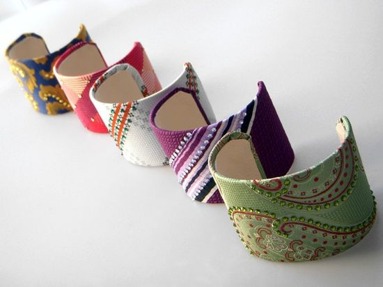 This is really clever and I've always had a thing for vintage ties!!! Recycled neck ties on aluminum adjustable cuffs. Embellished w/ Swarovski crystals.