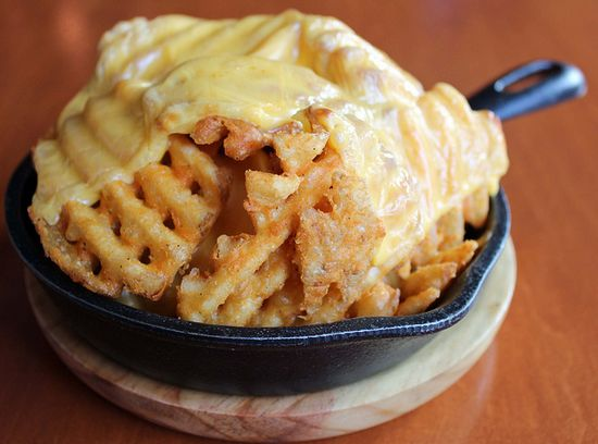 Waffle Fries with melted American cheese