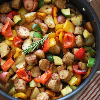 Lean Italian chicken sausage with summer bell peppers and zucchini sauteed with baby red potatoes and fresh herbs for a quick one pot meal. -This was a great dinner! I didn't have any fresh herbs on hand but my sausage was Italian chicken sausage so I figured it was enough. For leftovers tonight, I added an over easy egg on top with some Frank's hot sauce-YUM!!!!