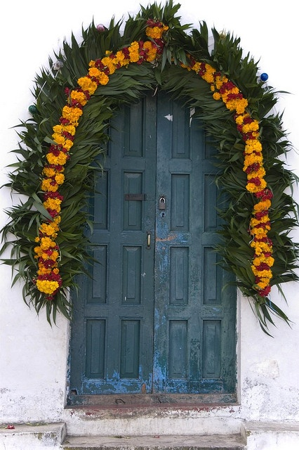Chapel Door - Zinacantan, Chiapas, Mexico...Marigolds decorate door for the Day of the Dead