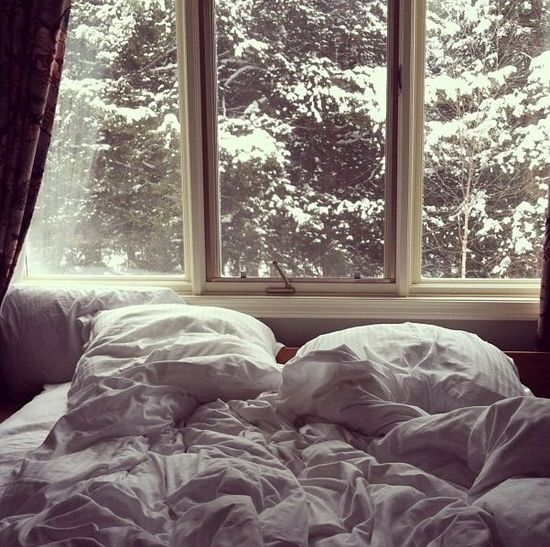 a comfy bed with the snow outside....