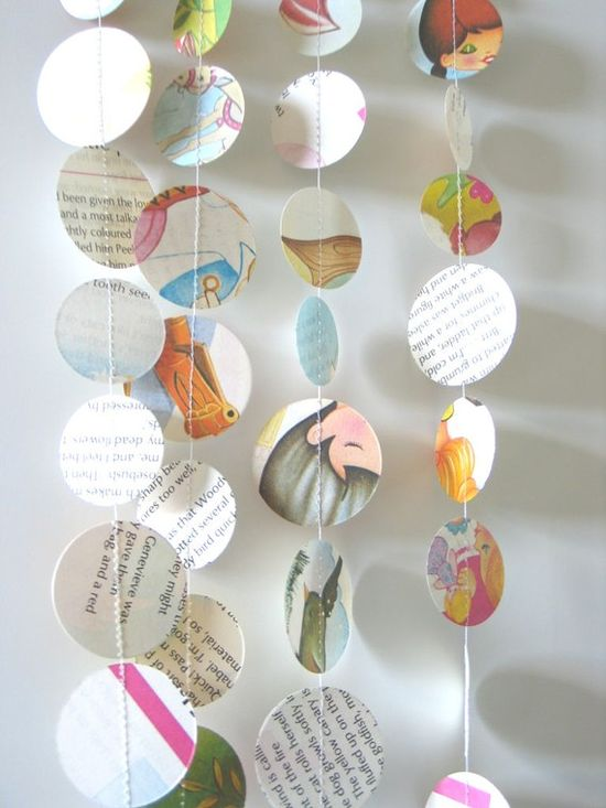 Paper punched vintage children's book... makes a great mobile or garland.