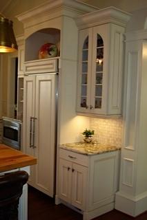 Under cabinet lighting accents the beautiful tile backsplash.
