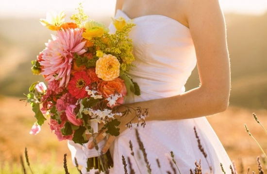Zinnias + cascading wildflowers are truly divine in this boho bridal bouquet.