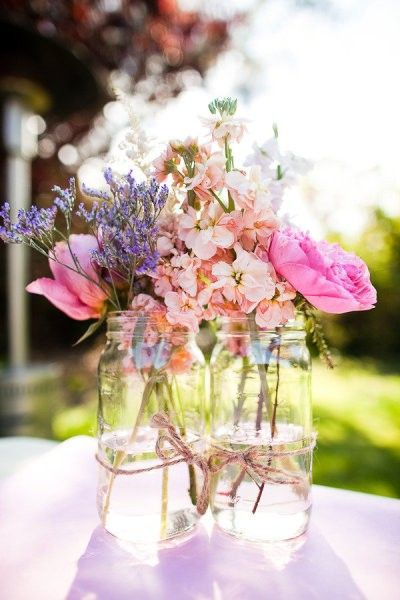 Mason jar vases tied with twine. And gorgeous flowers. I do enjoy this.