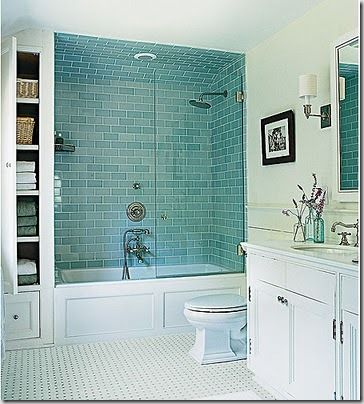 aqua glass subway tile. love the nook on the side of the shower!