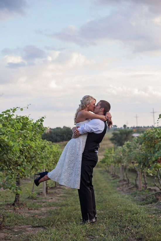 Wedding Photo inbetween grape vines