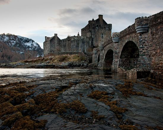 Eilean Donan Castle - originally built during King of Scots reign of Alexander II (ruled 1214 to 1249), destroyed 1719, rebuilt between 1919 and 1932 with a WWI war memorial, opened to the public in 1955 and managed by the Conchra Charitable Trust - now a popular tourist attraction and recognized as a Scottish icon - island in Loch Duich, near the village of Dornie, western Highlands of Scotland