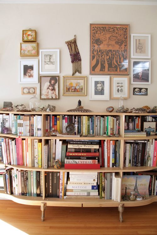 I might have to try this:  remove drawers from a dresser and use it as a bookshelf.