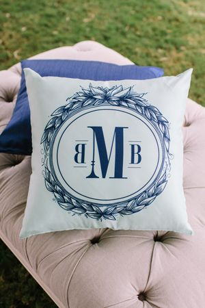 monogrammed pillow at reception