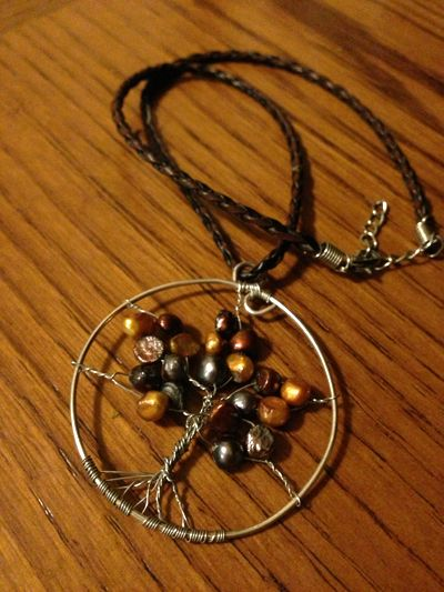 I have one very similar! I get so many compliments!  Wire wrapped tree necklace #jewelry #DIY