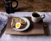 use a beautiful wood cutting board as a breakfast tray.