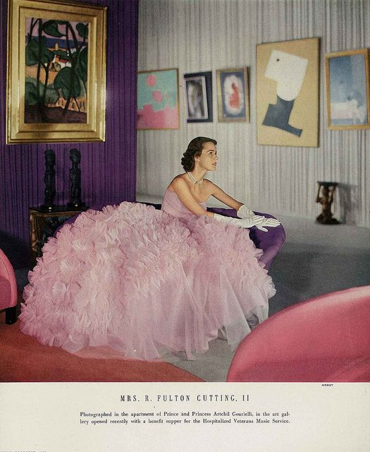 """Mrs Cutting is wearing a froth of a ball dress, the skirt is foaming with ruffles, by Ceil Chapman."" #pink #dress #gown #vintage #fashion #1950s"