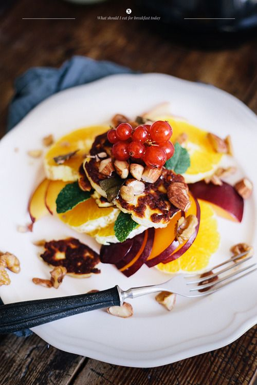 Fried haloumi with fruit salad, nuts and herbs