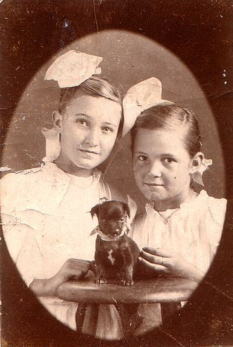 Edwardian girls with chihuahua puppy