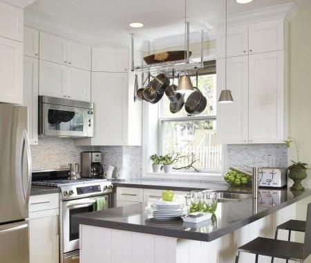 Small efficient kitchen design with white kitchen cabinets, gray quartz