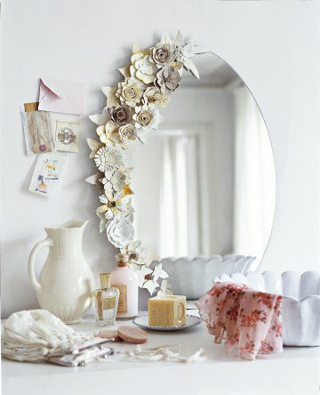 mirror lined with cardboard flowers