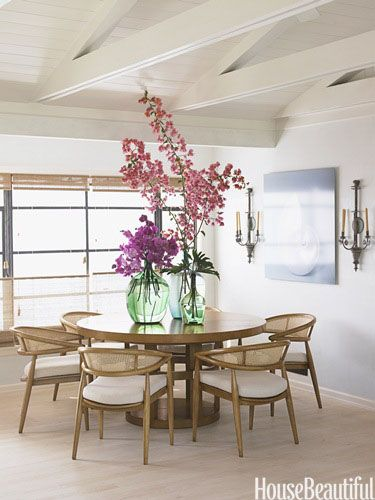 "The open table base and caned chairs give this room a ""beachy"" feel. Design: Chris Barrett for KAA Design Group."