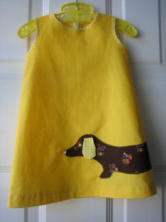 sausage dog ~ know a couple of little girls that would really like this sweet dress!  Doesn't look like that would be too hard to add to a little dress!