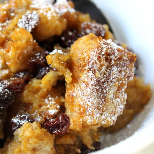 Dairy-Free Pumpkin Bread Pudding: a healthy end to your Thanksgiving meal  8 slices whole wheat bread (day-old is best)  2 cups unsweetened almond milk  1/2 cup brown sugar  2 tablespoons maple syrup  1 teaspoon vanilla  1 cup pumpkin puree  1/2 cup raisins  1/2 teaspoon ground cinnamon  Powdered sugar (optional)