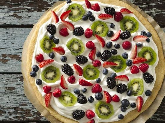 Try a sweet dessert pizza made with a rich sugar-cookie crust, frosting, whipped cream and your favorite fresh fruit.