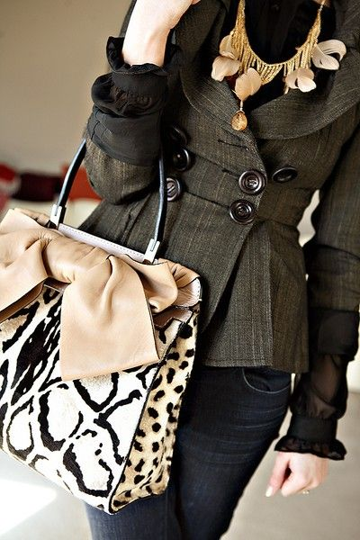 the handbag. love the cut of the jacket too.