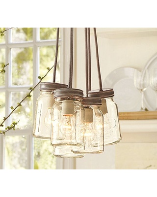 We love this pendant light made from canning jars! Get it here: www.bhg.com/...
