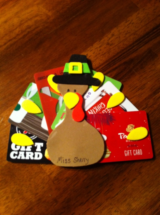 Thanksgiving Teacher gift: $1 foam turkey craft from Michaels and six $5 gift cards to different restaurants to make the feathers. The back of the turkey says: I'm thankful for (name of teacher) and the child signs his/her name.