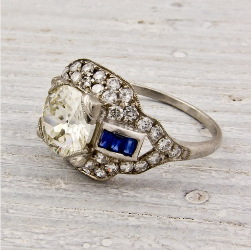 Estate diamond and sapphire ring set in platinum