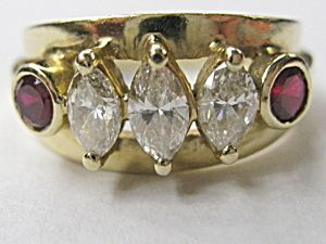DIAMOND MARQUISE BAND WITH RUBIES