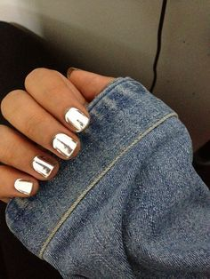 Chromed out nails. Metallic silver manicure.