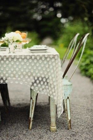 see-thru polka dot table cloth over rustic table