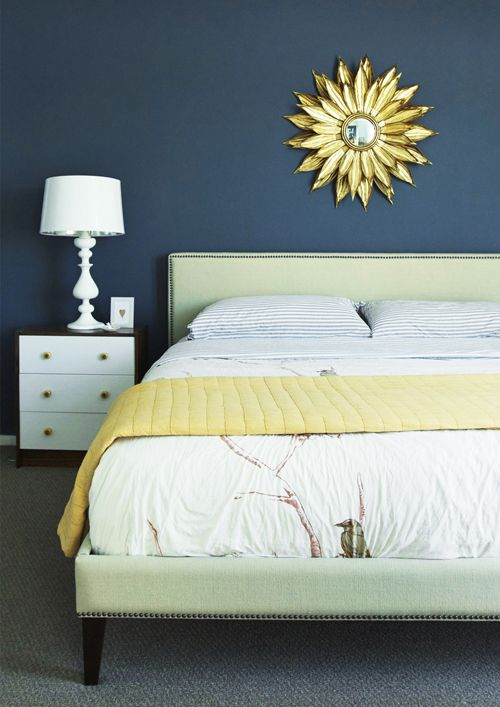 bedroom: navy walls and light-colored accents