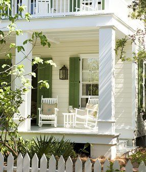 love the green shutters and picket