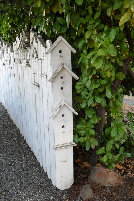 I love this birdhouse fence.