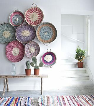 Elle Decor, baskets on the wall