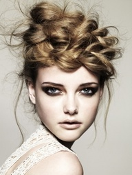 Love it! Messy Braid on the Top of the Head.