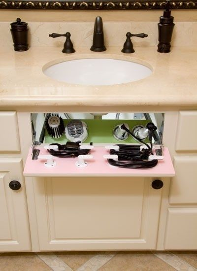 Turn the fake drawer in your cabinet into a hair dryer/straight iron storage space.  Love this idea!