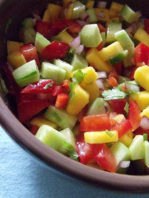 Mango Cucumber Salsa, on top of chicken breast, crackers, inside a pepper...