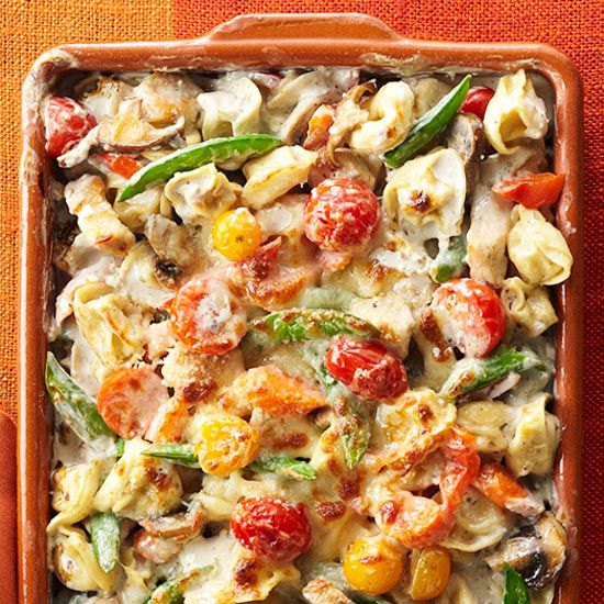 Tortellini-Vegetable Bake //  Forget bland pasta bakes and dig into this garden-fresh vegetable casserole. More summer casserole recipes: www.bhg.com/...