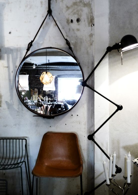 hanging mirror, leather chair