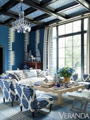 blue living room. Isn`t this blue and white wallpaper interesting. I haven`t seen anything quite like this ikat print wallpaper and I think I like it. The wallpapered ceiling is neat too.