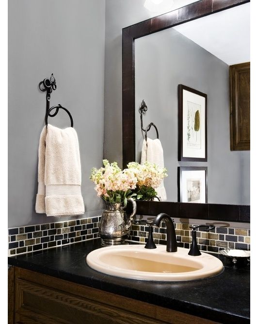 I like the gray walls and the black sink top/fixtures... the tile is a nice idea too, but not sure i would go with this exactly. hmmmm