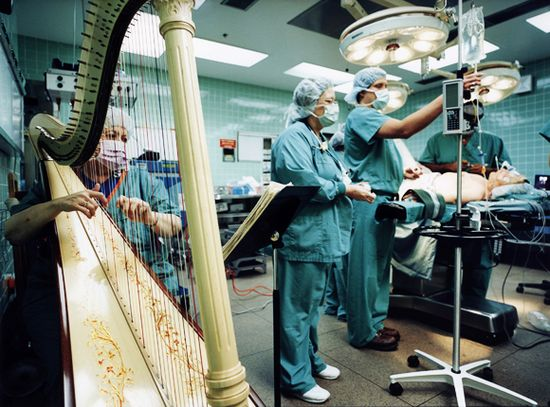 Music with a four-four tempo, which corresponds to normal heart rate or lyrical melodies & rhythms  of about sixty to eighty beats a minute (common to much classical music & bird song) can stimulate relaxation & alpha brain waves.....all of which makes us feel better!!! Yes please, if I were to have surgery and/or not!!!!