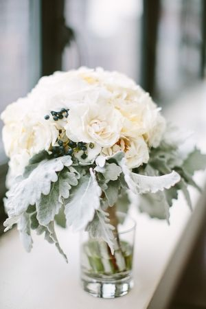 Ivory florals & winter berries make for a beautiful bridal bouquet.