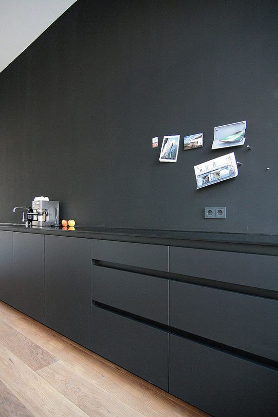I love love love this kitchen. Vegas Sparkles who cleans my kitchen would hate it. :: KITCHENS :: Matte, all-black kitchen instead of the usual all-white ones. Photo Credit: MO Architekten. - lovely, simple timeless #kitchens #MOArchitekten
