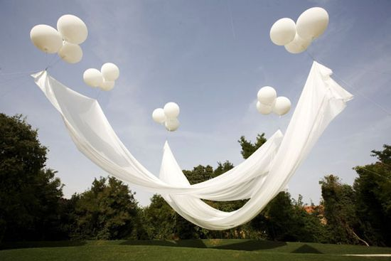 floating canopy: the balloons are attached to the ground with fishing line. so cool!
